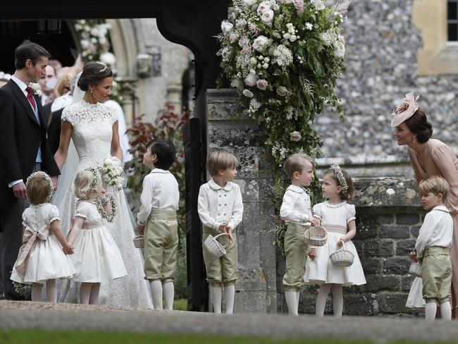 Kate plays with the children as her sister and brother-in-law watch on.