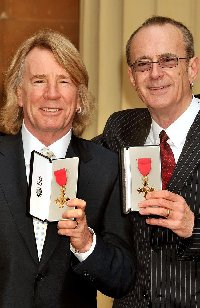 Rick Parfitt and Francis Rossi both received an OBE from the Queen in 2010. Picture: John Stillwell/WPA Pool/Getty Images