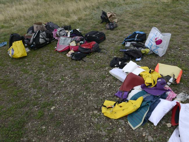 Subject to looting ... passengers' belongings lie at the site of the crash of a Malaysia Airlines plane carrying 298 people from Amsterdam to Kuala Lumpur. Picture: Alexander Khudoteply