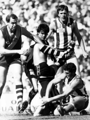 Peter Maynard (upside down) with Peter Carey, Tony Antrobus, Michael Redden and David Robertson in the 1985 SANFL Grand Final.