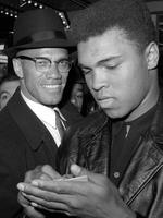 In this March 1, 1964, file photo, heavyweight boxing champion Muhammad Ali, right, is shown with black muslim leader Malcolm X outside the Trans-Lux Newsreel Theater in New York, after viewing the screening of a film about Ali's title fight with Sonny Liston. Picture: AP