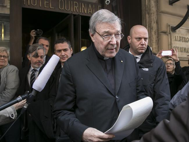 Public statement ... Cardinal Pell reads a statement to the media after a private meeting with the clergy victims at Hotel Quirinale in Rome. Picture: Ella Pellegrini
