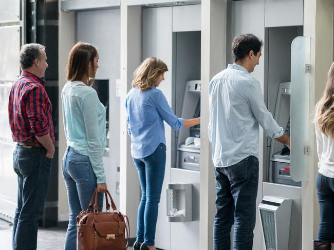 Generic picture of a group of people in a line at an ATM waiting to make a cash withdrawal. Picture: iStock