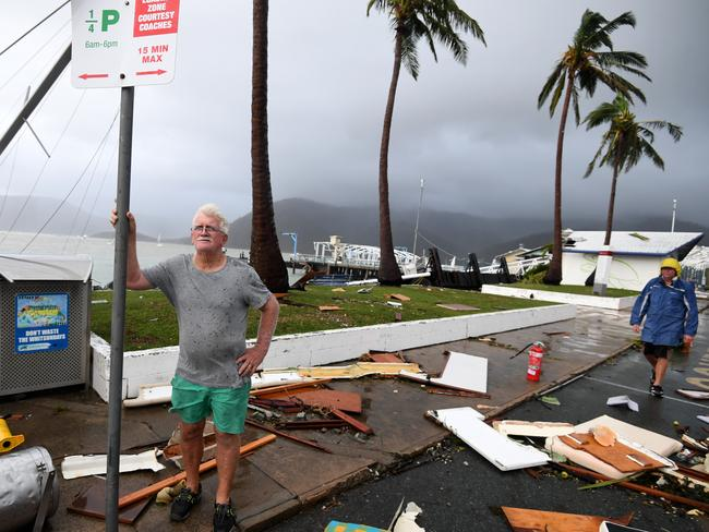Local council worker Brian Doyle inspects damage at Shute Harbour, Airlie Beach. Picture: Dan Peled/AAP