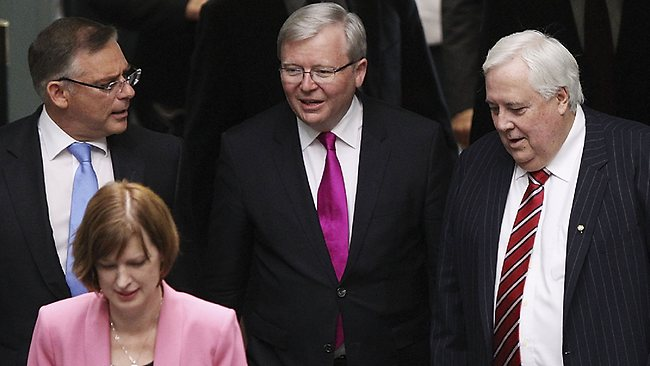 Kevin Rudd and Clive Palmer arrive at a swearing in ceremony on Tuesday in the House of Representatives chamber at Parliament House. Picture: Stefan Postles/Getty Images