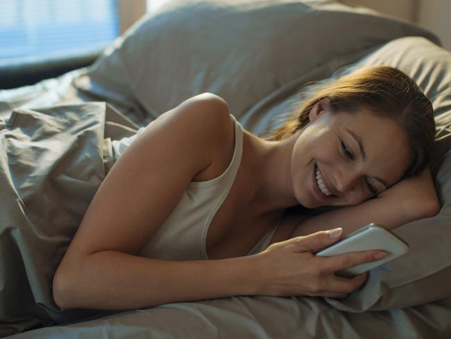 It's surprisingly easy to waste a lot of time scrolling through your phone in bed.