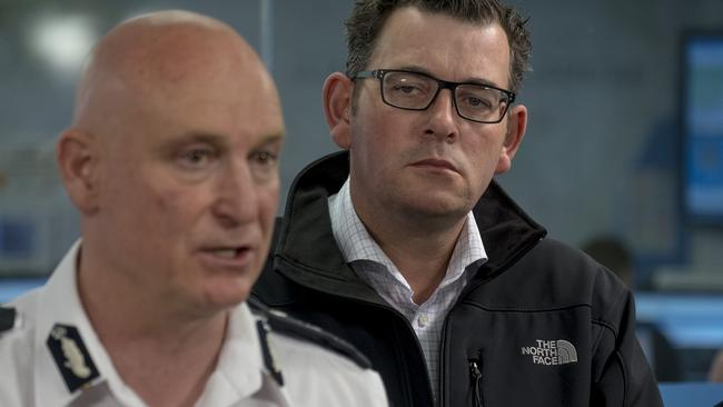Victoria's Emergency Management Commissioner Craig Lapsley and Victorian Premier Daniel Andrews talk on Saturday. Picture: AAP Image/Luis Enrique Ascui.
