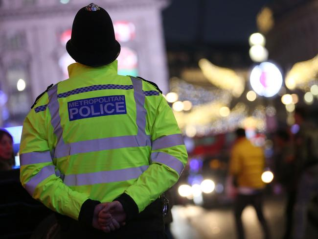 A British Police officer stands on duty ahead of the New Year's celebrations, in central London on December 31, 2016. Picture: AFP