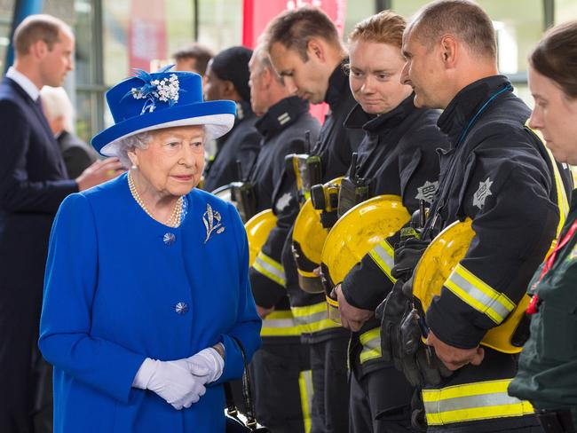 Queen Elizabeth II thanks firefighters during a visit to the Westway Sports Centre which is providing temporary shelter for those who have been made homeless in the Grenfell Tower disaster. Picture: AFP PHOTO
