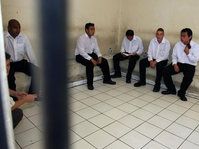 Sukumaran, left, and Chan, middle, with other Bali nine suspects in the cells at Denpasar Court before Renae Lawrence's trial. Picture: Lukman S Bintoro.