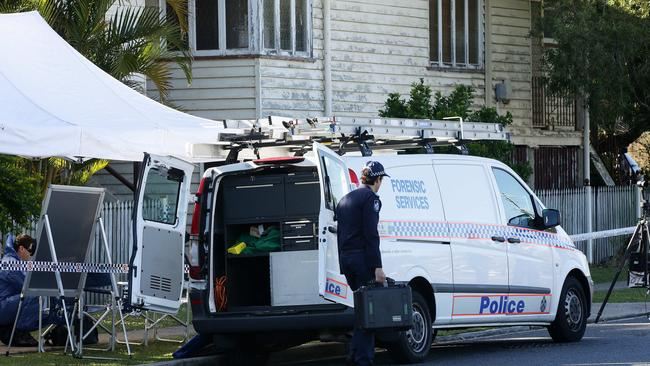 Police at the crime scene where a woman was beaten to death at a house in Milson St, Norman Park. Picture: Liam Kidston.