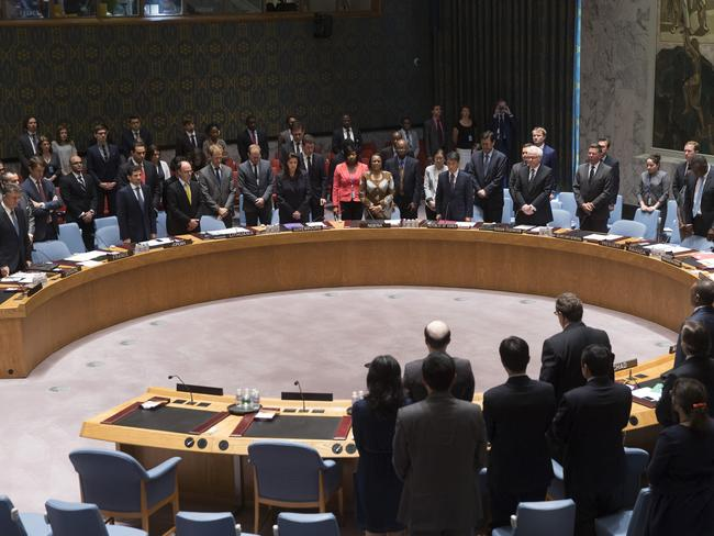 World mourns ... Members of the UN Security Council stand for a moment of silence for the lives lost on Malaysia Airlines Flight 17. Picture: John Minchillo