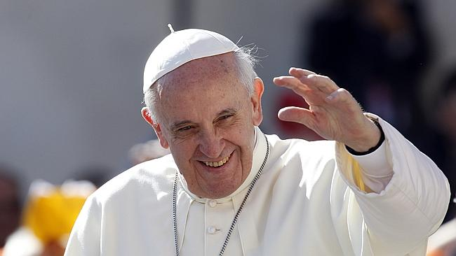 Pope Francis waves to faithful as he arrives for his weekly general audience in St. Peter's Square Picture: AP Riccardo De Luca.