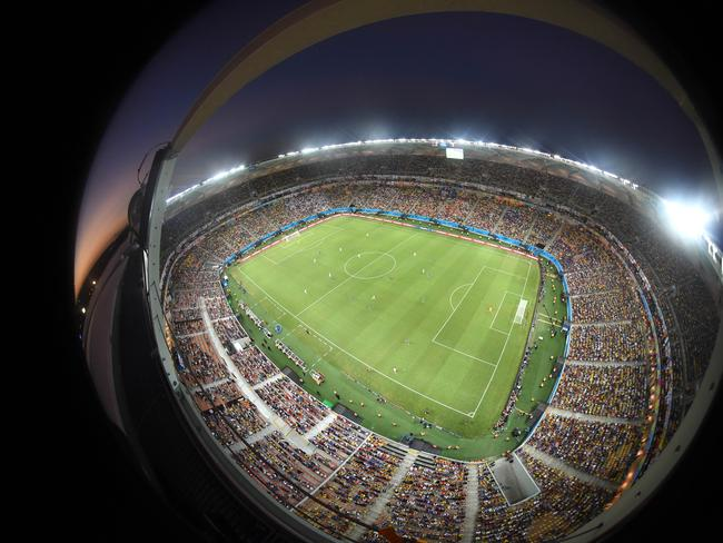 In this photo taken with a fisheye lens the teams run over the pitch during the group D World Cup match between England and Italy at the Arena da Amazonia in Manaus, Brazil.