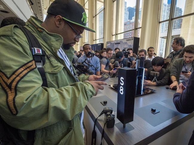 People test out the new Samsung Galaxy S8 at its launch in New York. Picture: Supplied