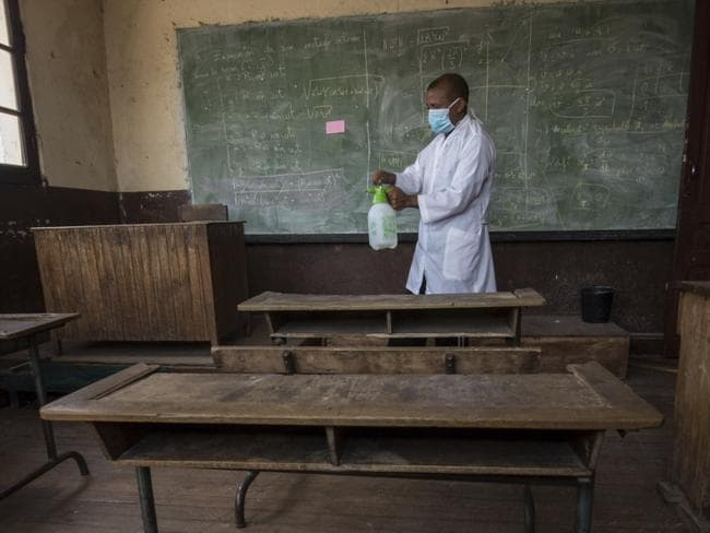 A school staff member sprays a classroom against the plague in Antananarivo as schools remain shut due to the outbreak. Picture: AP/Alexander Joe
