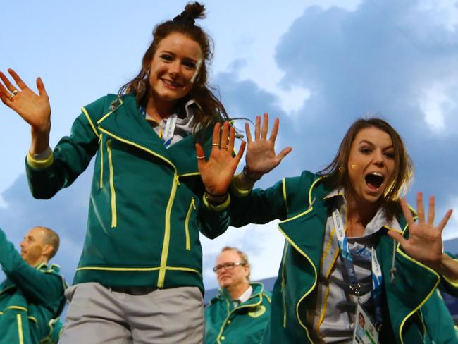 The Australian athletes wave as they arrive during the opening ceremony.