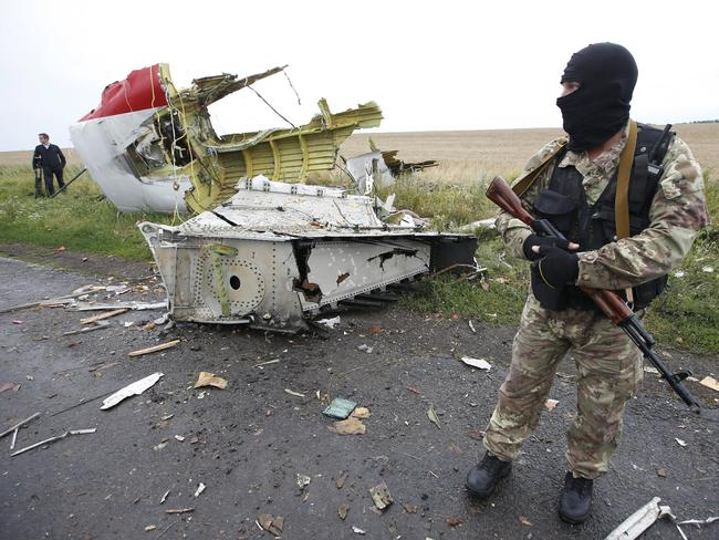Crash site ... A pro-Russian separatist stands at the crash site of MH17, near the settlement of Grabovo in the Donetsk region. Picture: Reuters