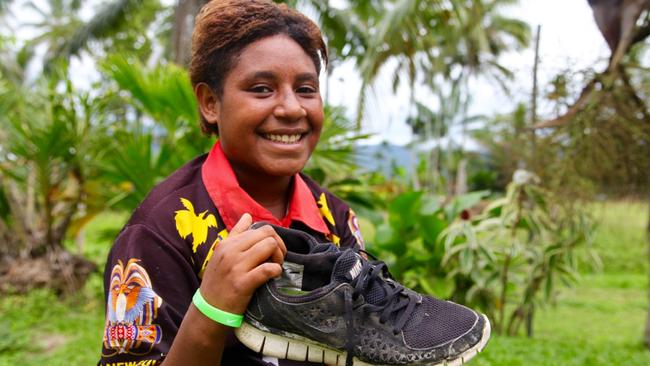 Pauline Soru with one of the shoes she says was gifted to her by Clemens. Picture: Ian Lloyd Neubauer