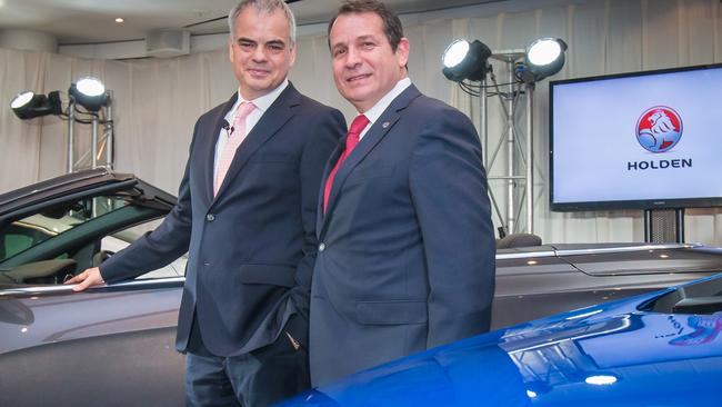 In happier times: Gerry Dorizas and Stefan Jacoby, GM Executive Vice President, unveil three new models for the Australian market. Picture: Mark Dadswell
