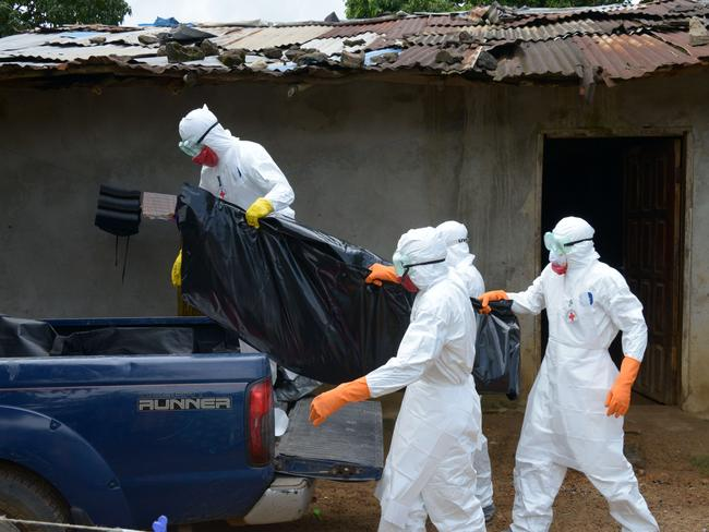'Literally exhausted' ... Red Cross volunteers conduct the hands-on work of treating the infected, retrieving corpses of victims from far-flung sites and fighting rumours on the ground about Ebola. Picture: Dominique Faget