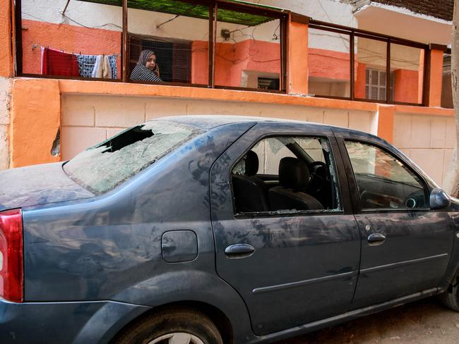 A damaged car in the area of the attack outside the Mar Mina church south of Cairo. Picture: AFP/Samer Abdallah