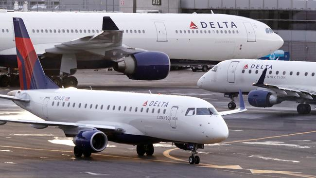 Crystal Tadlock said Delta should have warned passengers they could not deplane with the complimentary snack. Picture: AP/Charles Krupa