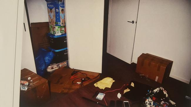 The bedroom and closet where the victim was detained, with jumper leads on the floor and a butane canister on the bed. Picture: SA Police