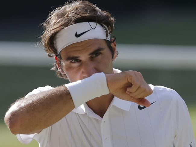 Roger Federer wipes his face. So he does sweat.