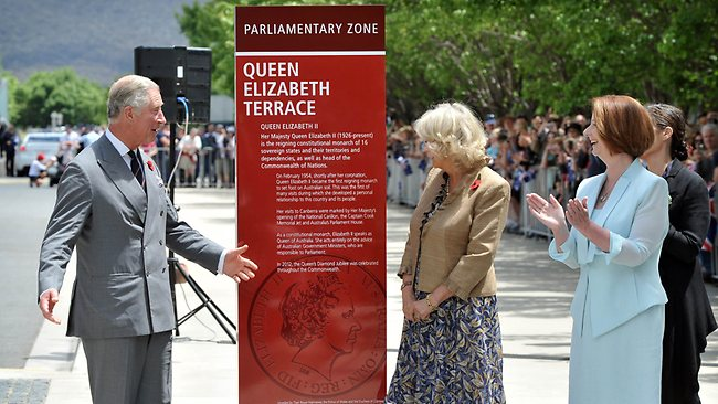 The royal couple and Prime Minister Julia Gillard unveil a plaque to rename a road Queen Elizabeth Terrace in Canberra.