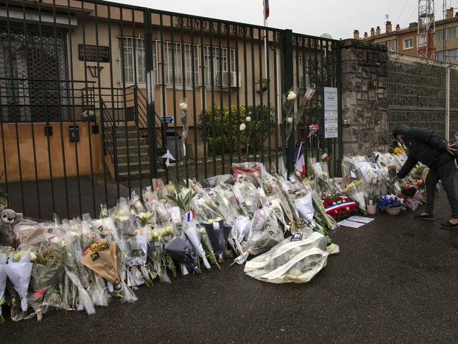 Many have laid flowers outside the local police station in memory of the lives lost on Friday in Trebes. (AP Photo/Emilio Morenatti)