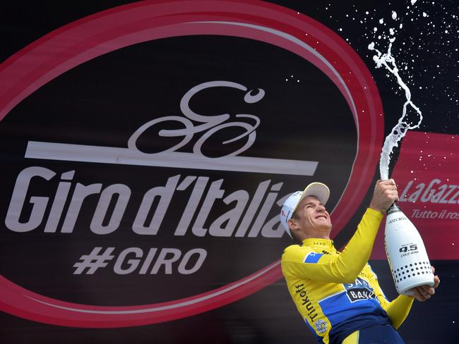 Australia's Michael Rogers celebrates on the podium after winning the 20th stage of the Giro d'Italia.