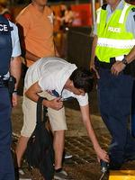 Police confiscated alcohol in Surfers Paradise.