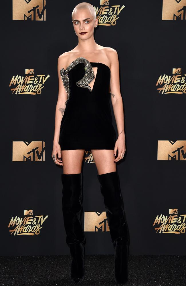 She teamed the Valerian-inspired look with thigh-high boots.