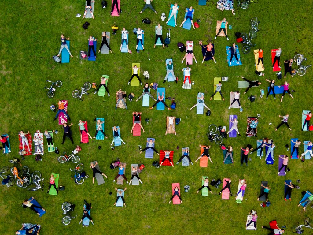 """People on mass yoga exercise in the central park of Vilnius."" Picture: Karolis Janulis, Lithuania, Shortlist, Open People, 2016 Sony World Photography Awards"