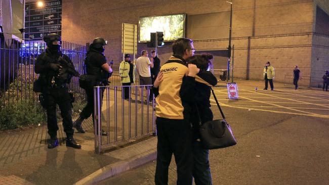 Armed police stand guard at Manchester Arena. Picture: AP
