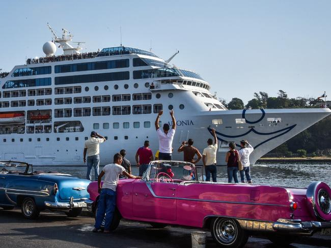 Cubans cheer as an American cruise ship sails into the port of Havana. Picture: AFP/Adalberto Roque