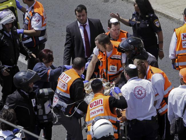 Emergency services evacuate an injured person from the scene of an stabbing attack in Jerusalem. Picture: AP