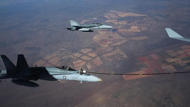 Training in the Northern Territory ... Australian fighter pilots Flight Lieutenants Chris Chmiel and Bart Langlands. Picture: Gary Ramage.