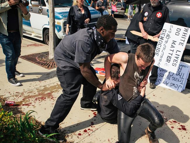 A small group of Ku Klux Klan members staging an anti-immigrant rally clashed with a larger gathering of counter-protesters. Picture: AP