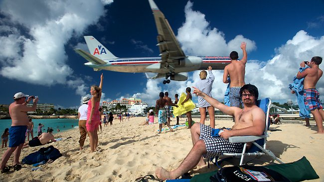 Soak up the sun and do a spot of plane watching at the same time. Picture: Qtschlepper/Flick