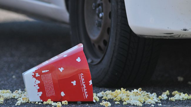 A Popcorn box lies on the ground outside Century 16 movie theatre where a gunmen attacked movie goers during an early morning screening of the new Batman movie. Picture: Thomas Cooper / Getty Images