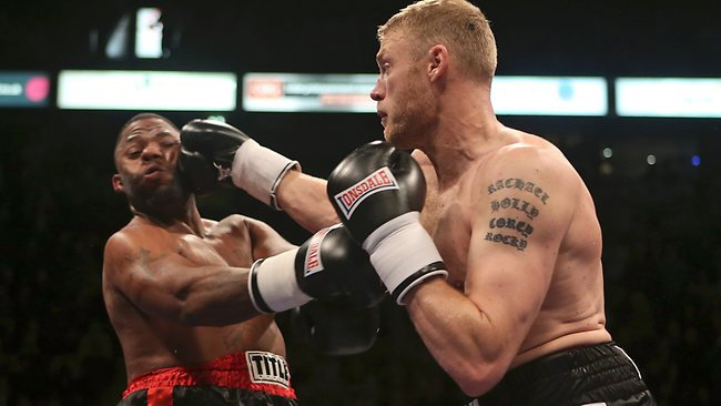 Andrew Flintoff, right, lands a punch against Richard Dawson during their fight in Manchester. Picture: Dave Thompson