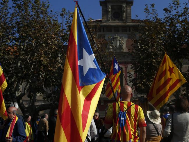Patriotic ... people hold 'estelada' or pro-independence flags at Parliament in Barcelona, Spain. Picture: AP Photo/Manu Fernandez