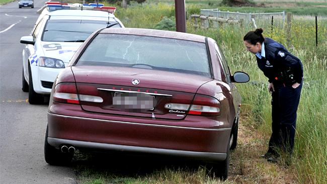 The victim's car was stolen and dumped in grassland 2km from her home.