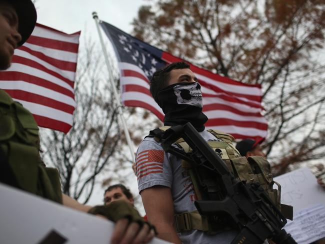Armed protesters from the Bureau of American-Islamic Relations (BAIR), stage a demonstration in front of the Islamic Association of North Texas at the Dallas Central Mosque on December 12, 2015 in Richardson, Texas. Picture: AFP