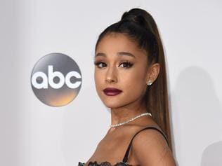 "(FILES) This file photo taken on November 20, 2016, shows US singer Ariana Grande arriving for the 2016 American Music Awards in Los Angeles, California. British police said early May 23, 2017, that there were ""a number of confirmed fatalities"" after reports of at least one explosion during concert by Ariana Grande in the city of Manchester. / AFP PHOTO / Valerie Macon"