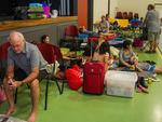 Cooktown residents arrive at the local cylone evacuation centre on Friday. Picture: Brian Cassey