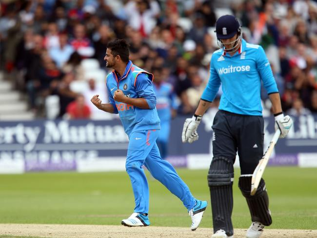 India's Suresh Raina, left, celebrates taking the wicket of England's Alex Hales. Picture: Simon Cooper
