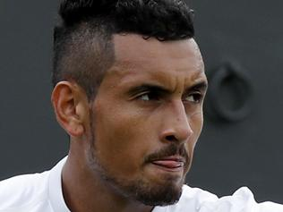 Nick Kyrgios of Australia gestures during his men's singles match against Radek Stepanek of the Czech Republic on day two of the Wimbledon Tennis Championships in London, Tuesday, June 28, 2016. (AP Photo/Ben Curtis)